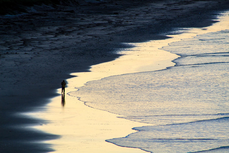 ExploreEverything Morning Santa Barbara, CA Backpacker Photography Beauty In Nature Fisherman Fishing Landscape One Person Pacific Ocean Real People Sand Reflection Shadow Sky
