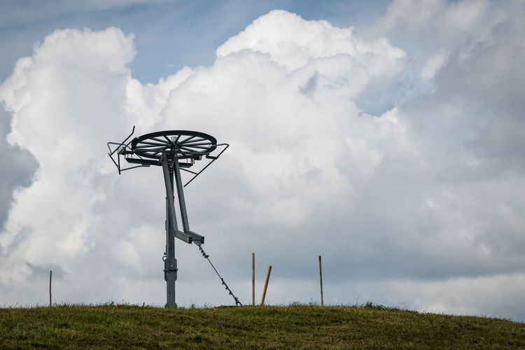 abandoned ski lift Ski Lift Cloud - Sky Sky No People Low Angle View Day Nature Environment Fuel And Power Generation Technology Land Field Landscape Outdoors Grass Tranquility Beauty In Nature Electricity  Tranquil Scene Rural Scene Environmental Conservation Power Supply