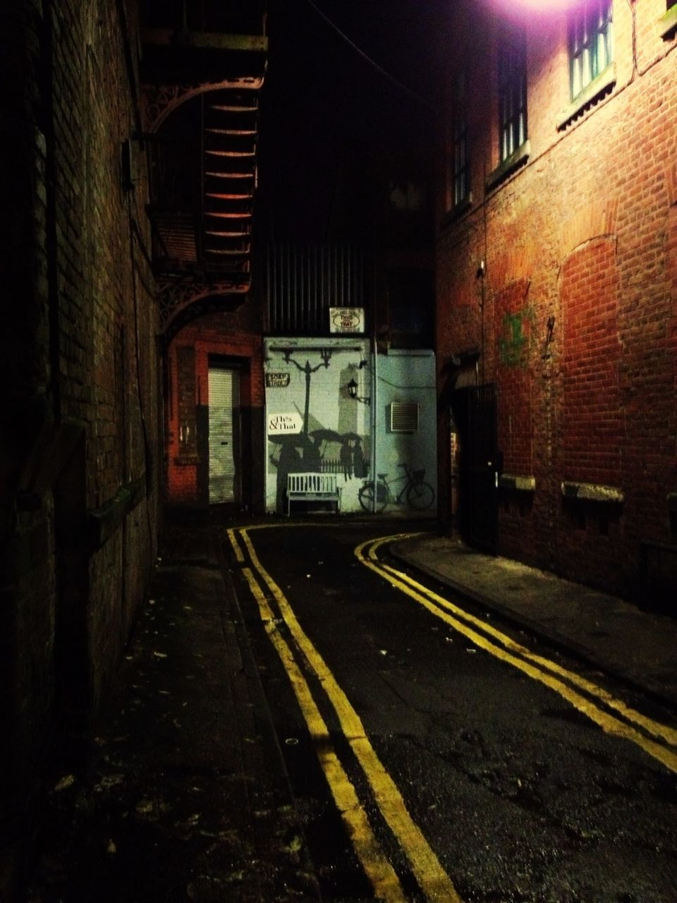 architecture, built structure, brick wall, illuminated, building exterior, no people, transportation, indoors, night