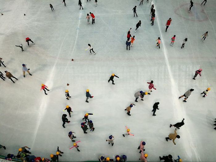 High angle view of people doing ice skate on snow