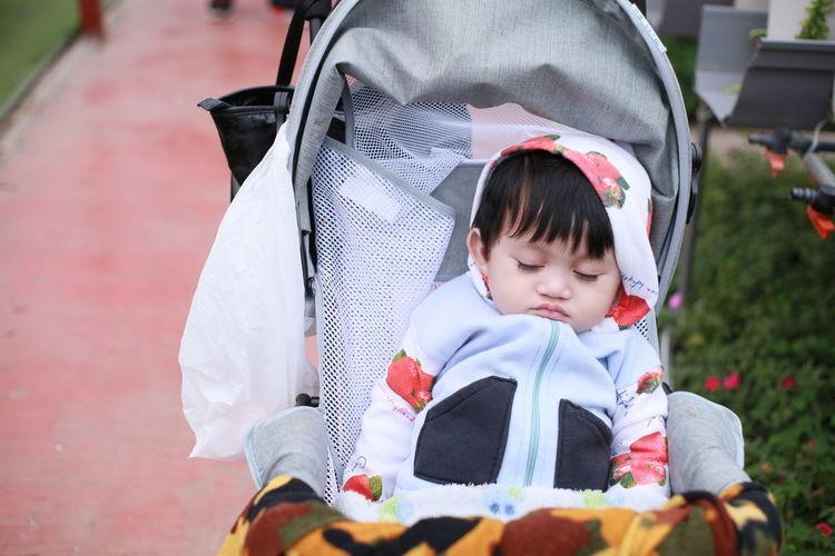 Cute baby boy sleeping in stroller