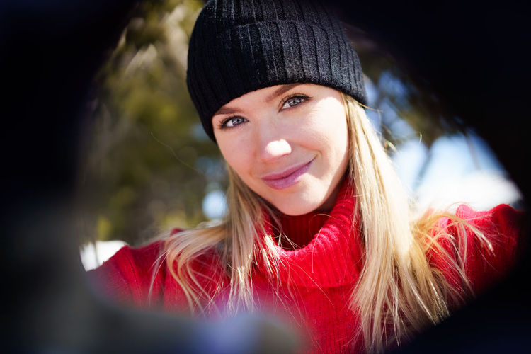 Portrait of a smiling young woman in winter