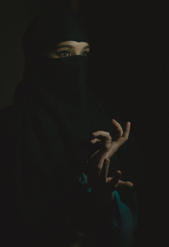 She Human Hand One Person Hand Portrait Indoors  Adult Black Background Studio Shot Human Body Part Headshot Women Unrecognizable Person Dark Body Part Real People Young Adult Obscured Face Looking At Camera Front View Finger Human Face