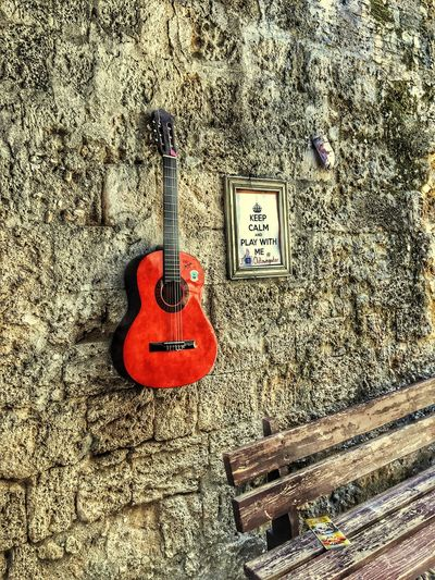 Keep calm and play 🤘🏼 Rhodes Travel Photography Greece Old Town Walls Architecture String Instrument Music Musical Instrument Guitar Arts Culture And Entertainment No People Musical Instrument String Still Life Wall - Building Feature Close-up Textured  Day