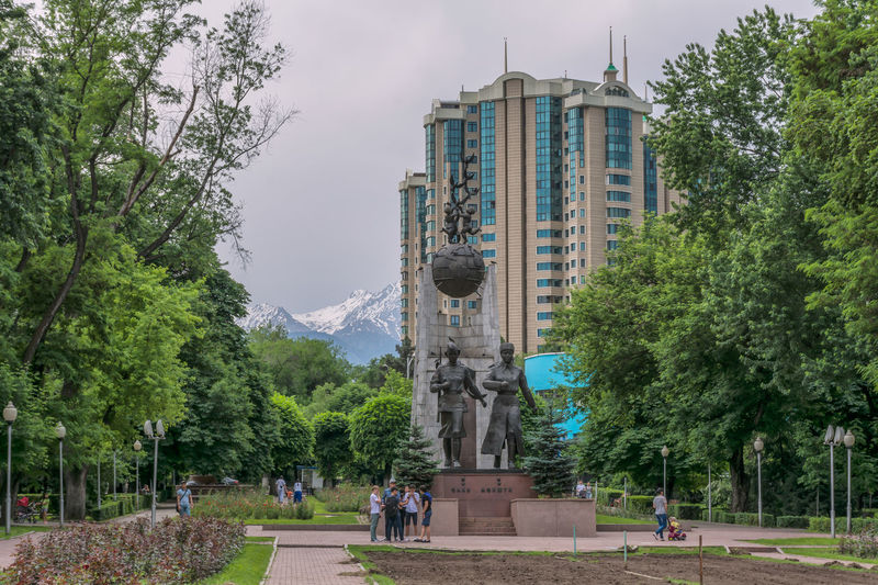 Statue in front of historical building