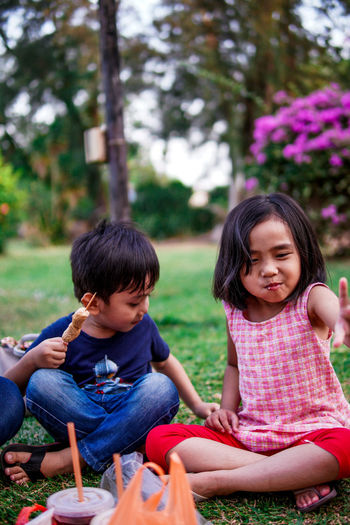 Boy and girl sitting outdoor