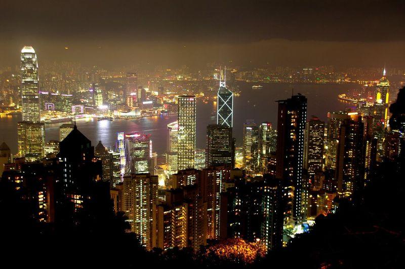 High angle view of cityscape illuminated at night