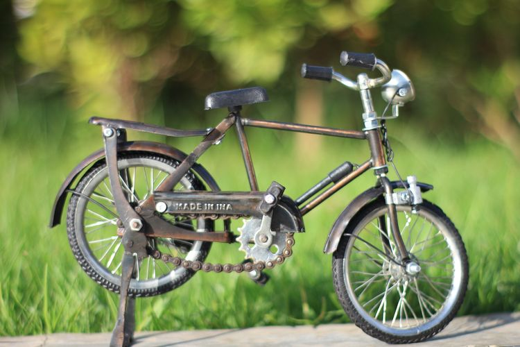Aceh Tourism Transportation Land Vehicle Mode Of Transportation No People Day Field Focus On Foreground Wheel Stationary Bicycle Outdoors Land Metal Green Color Technology Plant Nature Photography Themes Absence