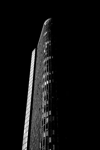 Low angle view of modern building against sky at night