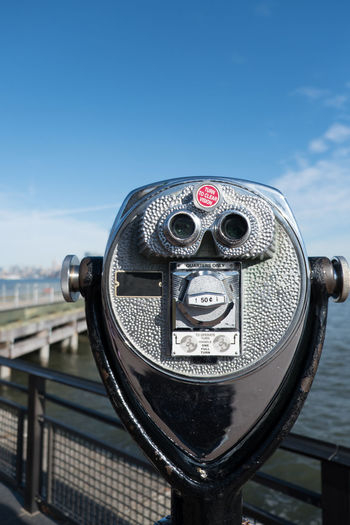 Tower viewer binoculars on Liberty Island looking towards Manhattan, New York. Pier and Manhattan skyline in the distance. Shallow depth of field, focus on telescoping tower viewer in the foreground. Architecture Binoculars Cityscape Close-up Coin Operated Coin-operated Binoculars Ellis Island  Hudson River Hudson River Ny Liberty Island Manhattan Manhattan New York Manhattan Skyline Manhattan, New York City New York City New York City Photos New York Harbor New York Skyline  New York ❤ New York, New York No People Sightseeing Statue Of Liberty Statue Of Liberty New York Tower Viewer