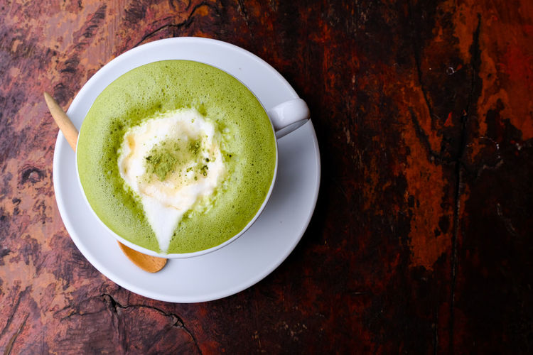 Greentea latte art, hot milk green tea, morning drink, afternoon drink, tea break, Japanese greentea EyeEmNewHere Japanese Green Tea Tea Break Greentea Hot Green Tea Milk Hot Green Tea Morning Drink Brown Wooden Table White Coffe Cup Honey Topping First Eyeem Photo