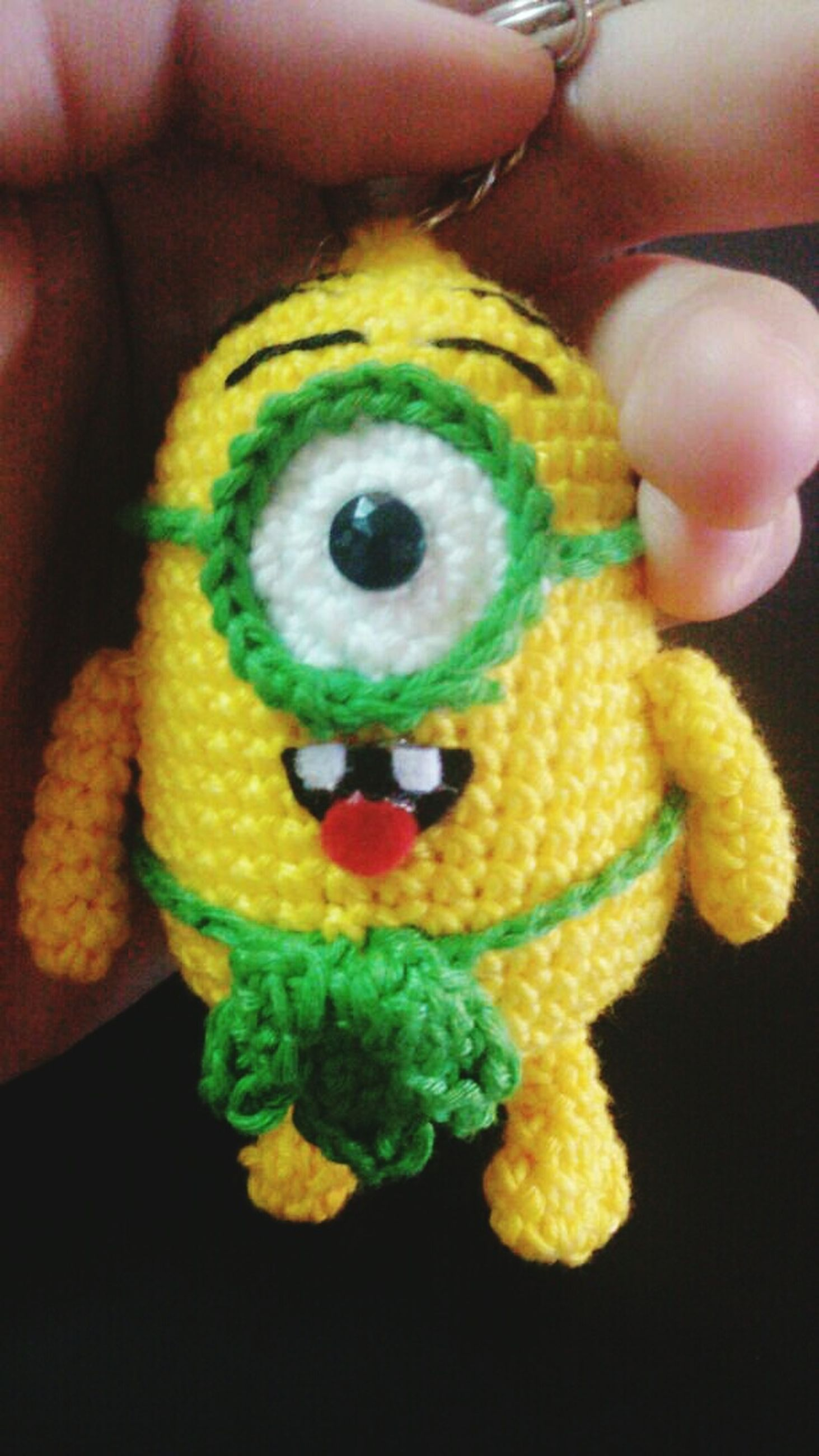 person, holding, part of, close-up, indoors, multi colored, human finger, cropped, unrecognizable person, animal themes, one animal, showing, food, lifestyles, toy, high angle view, yellow