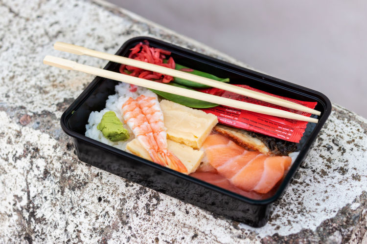 take away sushi Japanese Food Food Food And Drink Asian Food Seafood Sushi Rice Healthy Eating Freshness Chopsticks Fish Ready-to-eat Salmon - Seafood Rice - Food Staple Wellbeing Close-up Studio Shot Sashimi  No People Lunch Box Tray Soy Sauce Dinner