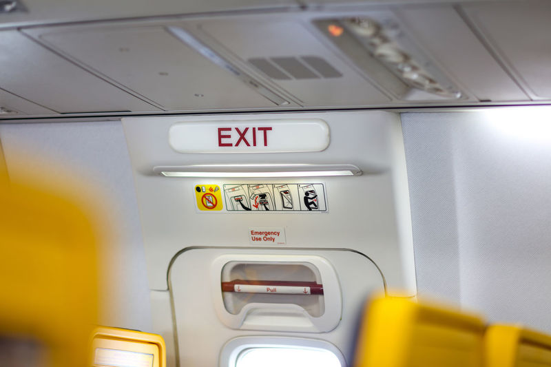 Close-up of exit sign in airplane