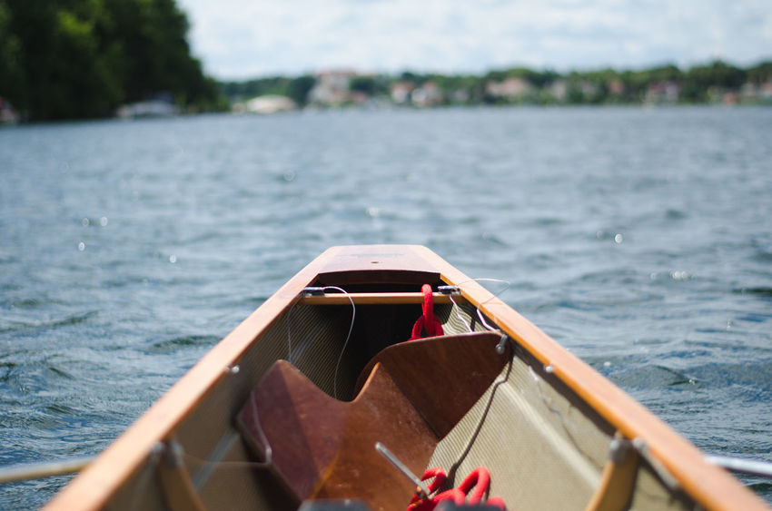 Canoe Canoeing Rowing Rowing Boat Adventure Beauty In Nature Day Focus On Foreground Lake Metal Mode Of Transportation Nature Nautical Vessel No People Oar Outdoors Rippled Sea Selective Focus Tranquility Transportation Water Watersports Wood - Material
