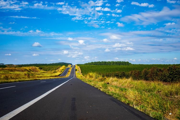 Miles away Summer Vibes Summer Exploratorium Road Sky Direction Landscape Cloud - Sky Rural Scene Summer Road Tripping Environment Land The Way Forward Field Scenics - Nature Tranquility Beauty In Nature Transportation Summer Road Tripping Summer In The City