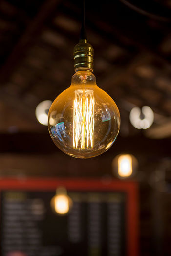 Light Bulb Lighting Equipment Electricity  Illuminated Filament Light Indoors  Electric Light Focus On Foreground Glass - Material Glowing Close-up No People Hanging Transparent Single Object Low Angle View Technology Fuel And Power Generation Bulb Ceiling Electric Lamp Electrical Equipment