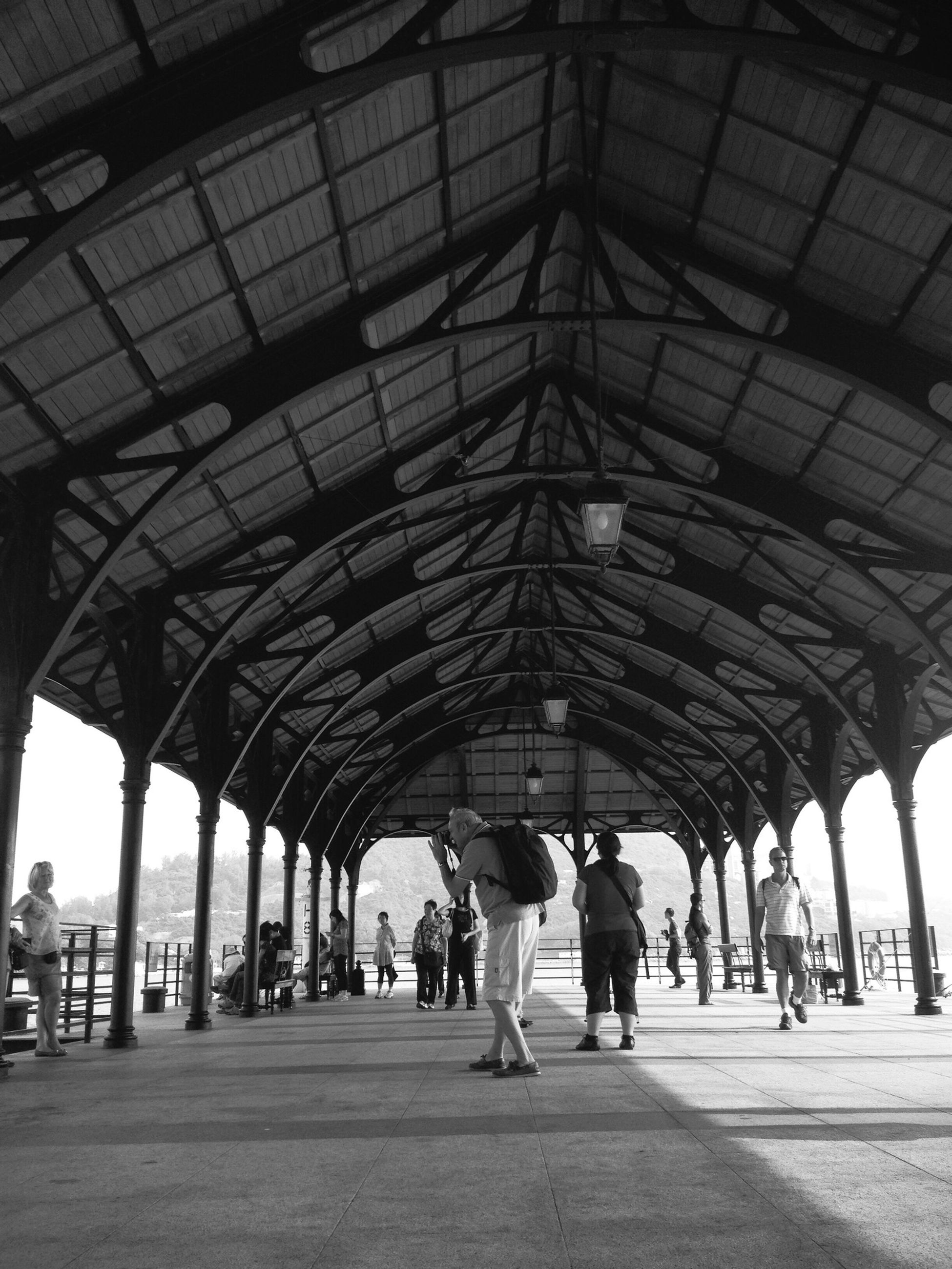 indoors, ceiling, architecture, built structure, men, arch, person, large group of people, the way forward, walking, lifestyles, transportation, travel, architectural column, railroad station, diminishing perspective, group of people, incidental people, leisure activity