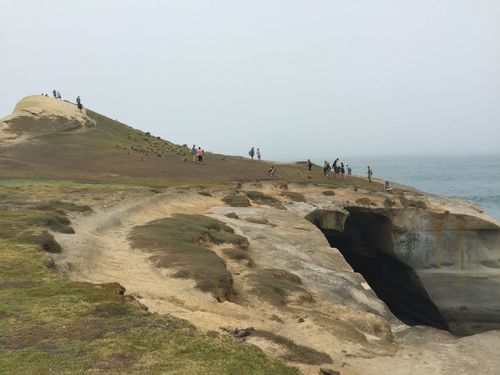 Beach Cliff Cliffs Cliffside Fog Foggy Geology Hidden Landscape Outdoor Outdoor Photography Outdoors Outside Pacific Ocean People Physical Geography Remote Rock Rock Formation Sand Sandstone Scenics Tranquil Scene The Tourist Tunnel Beach