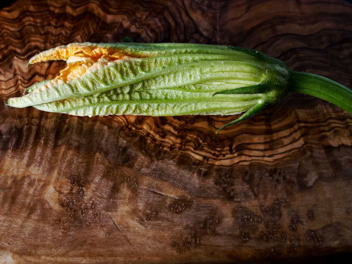 Courgette Flower Close-up Day Directly Above Food Food And Drink Freshness Green Color Healthy Eating Indoors  No People Organic Raw Food Single Object SLICE Still Life Studio Shot Vegetable Wellbeing Wood - Material