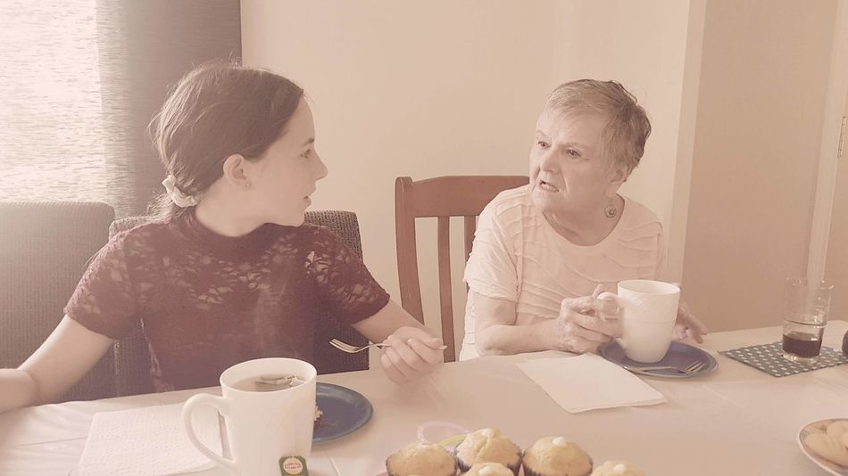 Family, generations Grandmother Granddaughter Generations Old And The Young Afternoon Natural Simplicity Natural Great Grandma Great Grand Daughter! Drink Tea - Hot Drink Young Women Domestic Life Sitting Togetherness Women Teapot Home Interior Coffee - Drink Tea Cup Afternoon Tea Beverage Scone