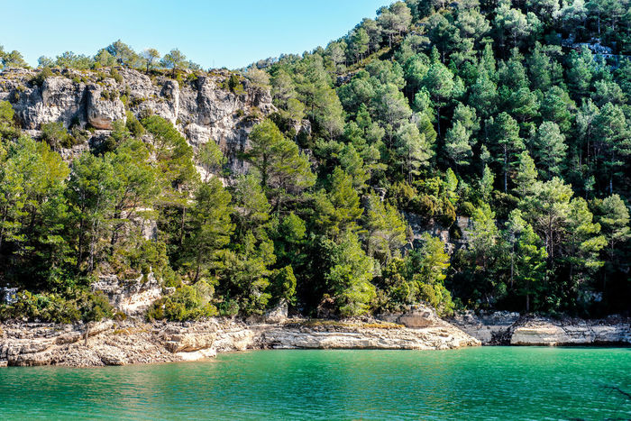 View of the Ulldecona reservoir. Valencian Community, Spain Beauty In Nature Europe Lake Landscape Mountain Nature Nobody Outdoors Reservoir Reservoir Dam River Rock Rock Formation Rocky Coast Rocky Mountains Scenery South SPAIN Sunny Day Travel Destinations Trees Turquoise Water Ulldecona Water Waterside
