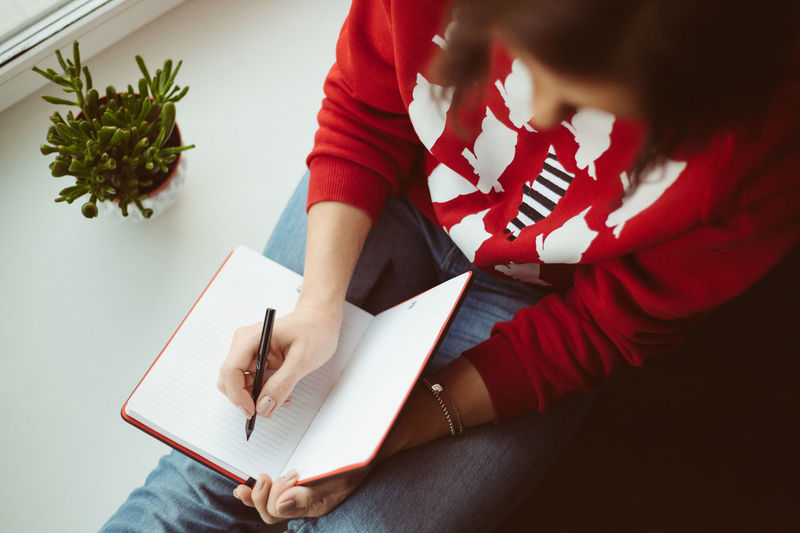 Girl writes in notebook in a cozy place. Warm colors Authentic Moments Autumn Colors Be. Ready. Hands Wintertime Write Writer Writing Authentic Beginnings Cozy Cozy At Home Cozy Atmosphere Cozy Moments Cozy Place Cozytime Girl Note Note Pad Notebook Warm Warm Clothing Warm Colors Writing Instrument Writting EyeEm Ready