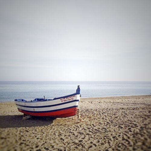 Boat on the beach Wave Beach Beauty In Nature Boat Day Horizon Horizon Over Water Land Moored Nature Nautical Vessel No People Outdoors Rowboat Sand Scenics - Nature Sea Sky Tranquil Scene Tranquility Water First Eyeem Photo