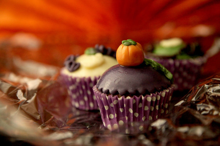 Close-up of halloween cupcakes on table