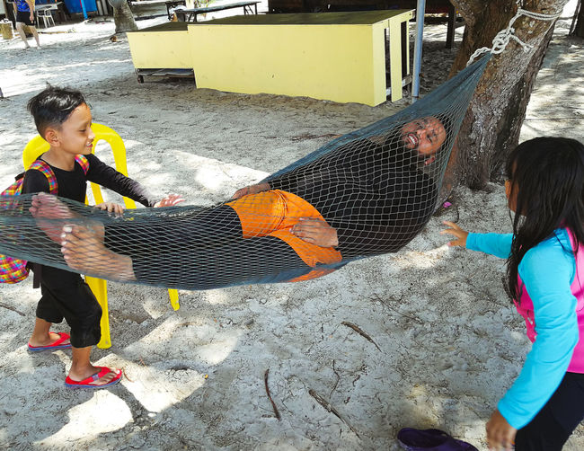 Pulau Redang, Terengganu. Real People Childhood Day Child Leisure Activity People Lifestyles Casual Clothing Women Water Nature Incidental People Girls Females Full Length Men Males  Outdoors Beach Innocence