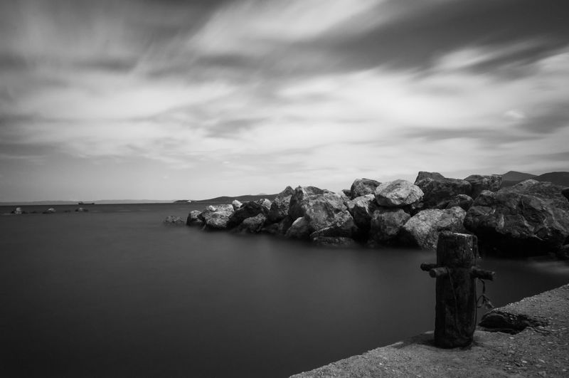 Almiros Beauty In Nature Beauty In Nature Black & White Calm Cloud Cloud - Sky Clouds And Sky Coastline Day Greece Long Exposure Shot ND Filter No People Non-urban Scene Outdoors Port Rock - Object Rock Formation Scenics Sea Sea And Sky Shore Sky Water
