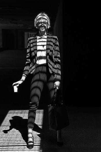 Portrait of smiling girl standing in dark room