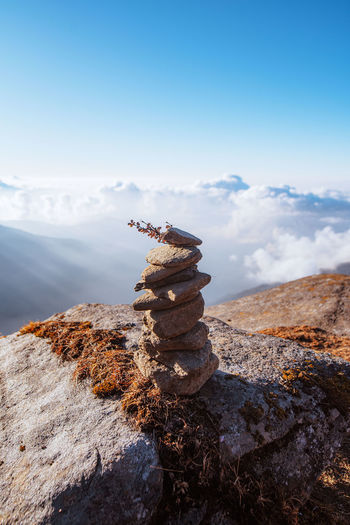 Stack of rocks on a hill against sky