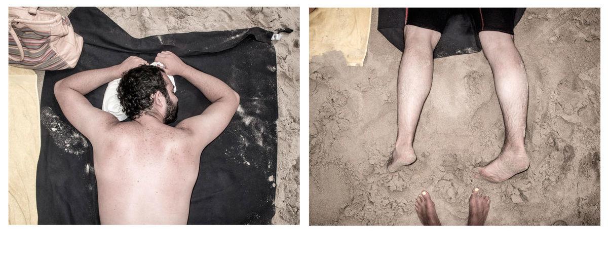 Man lying on sand