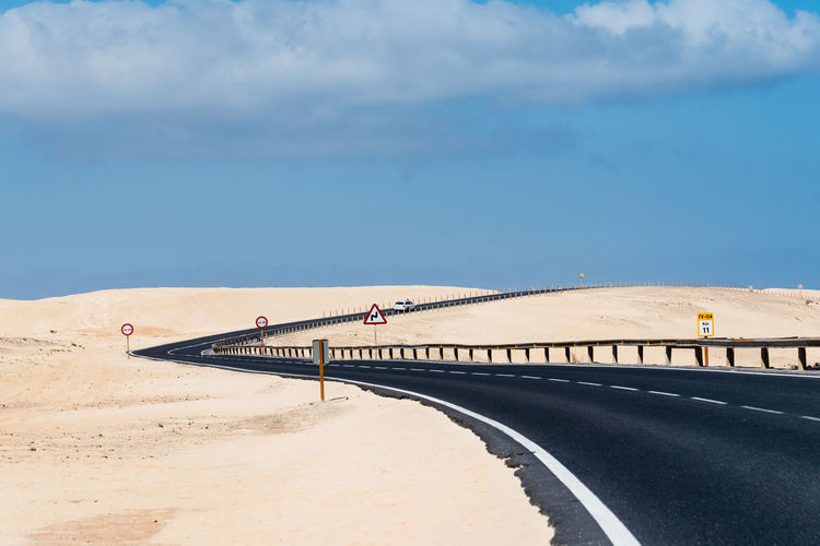 Road through dunes Desert Dunes Fuerteventura Road Travel Architecture Arid Climate Beach Bridge Cloud - Sky Connection Cruising Day Desert Beauty Environment Highway Land Nature Outdoors Sand Scenics - Nature Sea Sky Sunlight Transportation