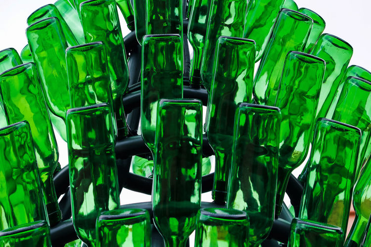 Green Color No People Indoors  Studio Shot Close-up Food And Drink Glass - Material Transparent White Background Still Life Man Made Object Empty Man Made In A Row Glass Large Group Of Objects Green Abundance Reflection Bottle