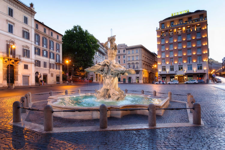 The Triton Fountain is located in Rome in Piazza Barberini. It is the work of Gian Lorenzo Bernini. It was made entirely of travertine marble in 1625. Ancient Architecture Barberini Square Bernini City City Street Fountain No People Place Rome Italy Sculture Storic