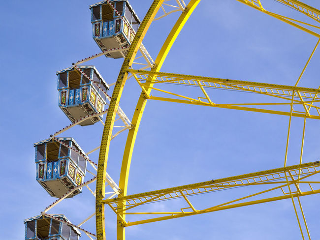Amusement Park Amusement Park Ride Architecture Arts Culture And Entertainment Blue Built Structure Clear Sky Day Excitement Fairground Ferris Wheel Fun Leisure Activity Low Angle View Metal Nature No People Outdoors Rollercoaster Sky Yellow