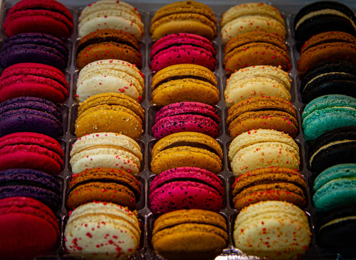 High angle view of multi colored macaroons for sale