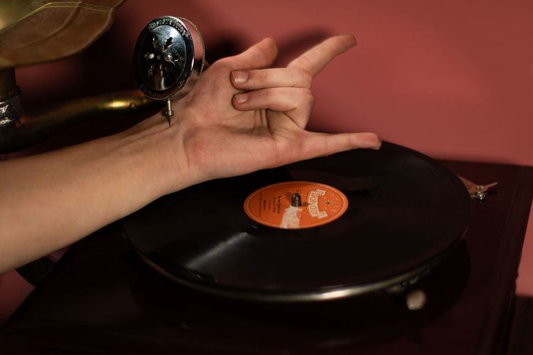 Heavy Metal in my veins ~ Analogue Sound Human Hand Hand Human Body Part Indoors  One Person Holding Close-up Table High Angle View Time Men Lifestyles Real People Adult Selective Focus Red Vinyl Needle Music Heavy Metal Gramophone