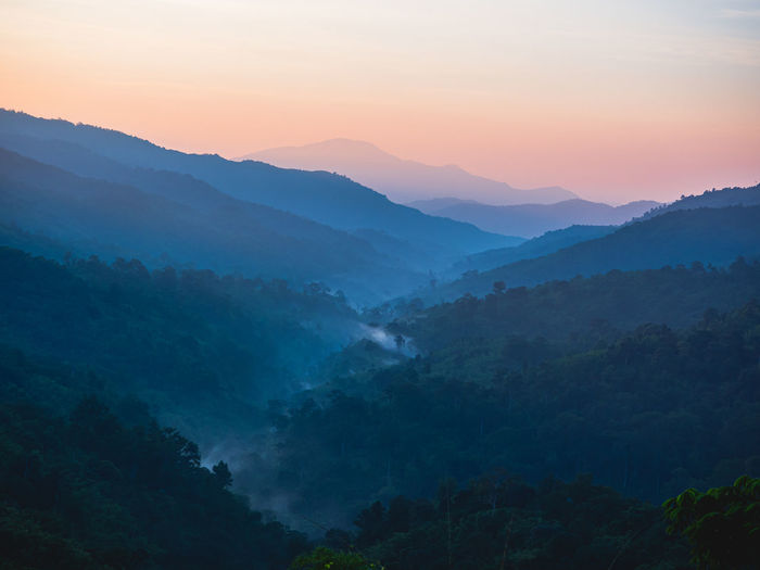 Beautiful nature of hills and mountain are complex with the atmosphere of the morning sunrise.