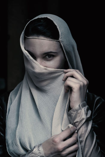 Amazing Beauty Black Background Body Part Clothing Covering Front View Girl Headshot Holding Hood Hood - Clothing Human Body Part Human Face Indoors  Looking At Camera Obscured Face One Person Portrait Real People Scarf Studio Shot Unrecognizable Person Waist Up Young Adult The Portraitist - 2018 EyeEm Awards
