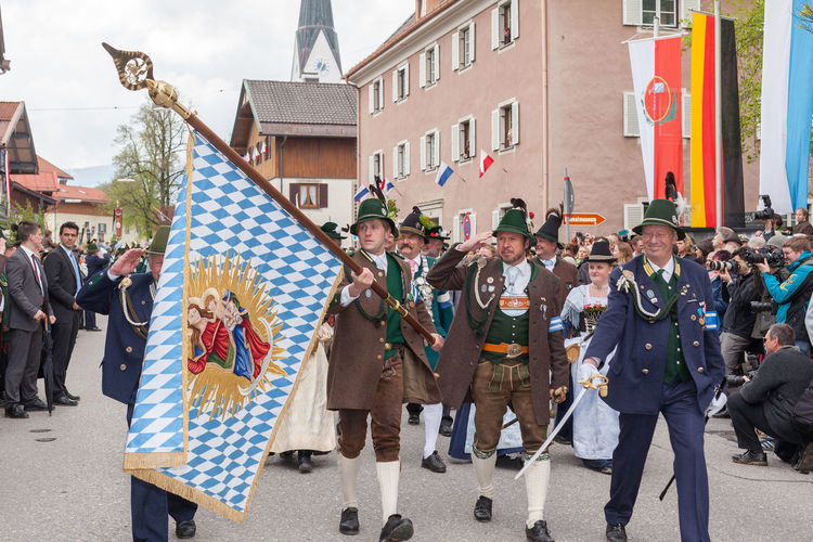 Miesbach, Bavaria, Germany, 04 May 2014: Bavarian flag of the mountain troops during the salute before the VIP box at the Year day protect mountain companies. 900 Years Old Bavaria Gebirgsschützen Mounten Troops Moving Tradition Adult Adults Only Built Structure Celebration City Country Flag Day Feast Day Procession Holding Large Group Of People Men Miesbach Outdoors People Protestor Real People Rostrum Togetherness Uniform