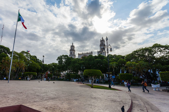 Adult Architecture Building Exterior Built Structure Cloud - Sky Day Flag Flags Large Group Of People Leisure Activity Lifestyles Main Square Men Mexico Mérida Yucatán Outdoors People Real People Sky Tree Women