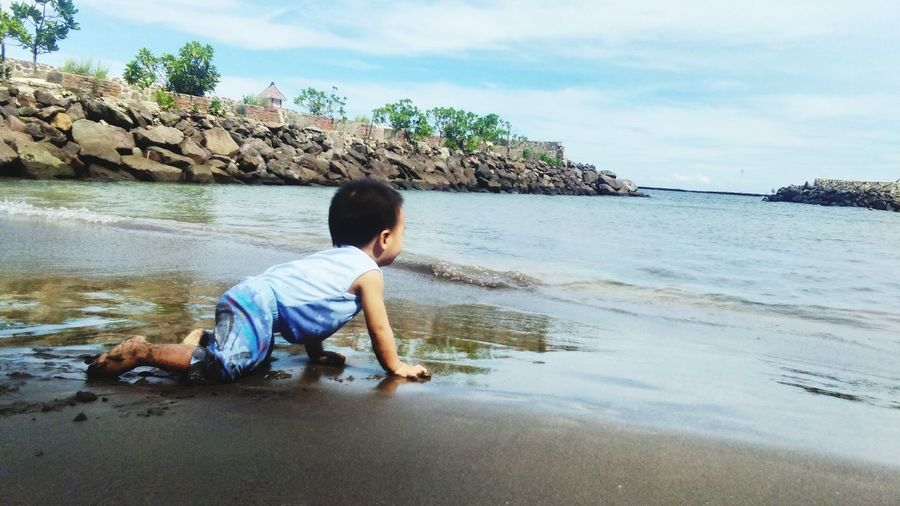 Baby and Beach EyeEmNewHere Beautifullplace Sweetbaby Water Tree Child Sea Males  Childhood Beach Boys Full Length Sand