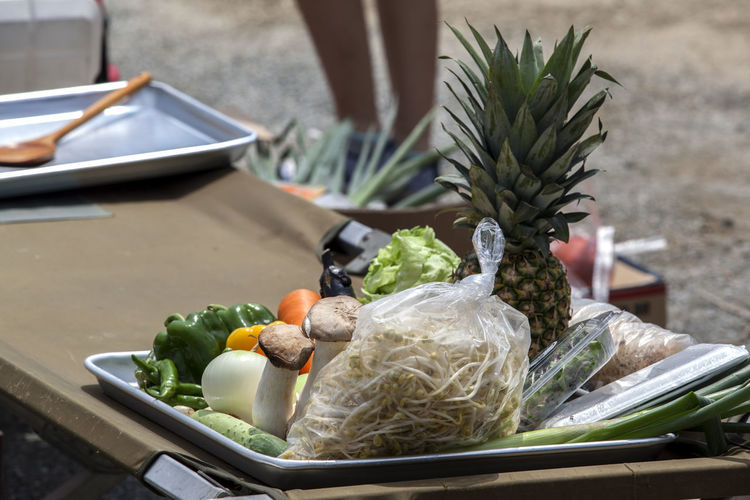 High angle view of vegetables with pineapple on table