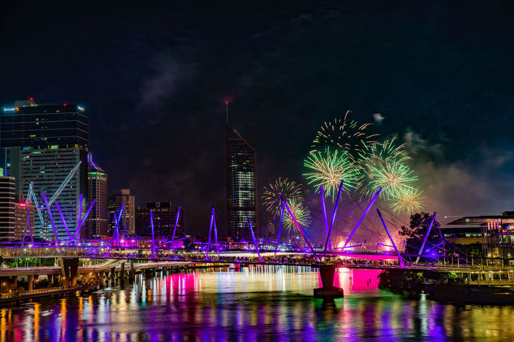 Architecture Bridge - Man Made Structure Brisbane Building Exterior Built Structure City Cityscape Firework - Man Made Object Firework Display Fireworks Harbor Illuminated Midnight Night No People Outdoors Reflection River River Fire River View Riverside Sky Skyscraper Travel Destinations Urban Skyline