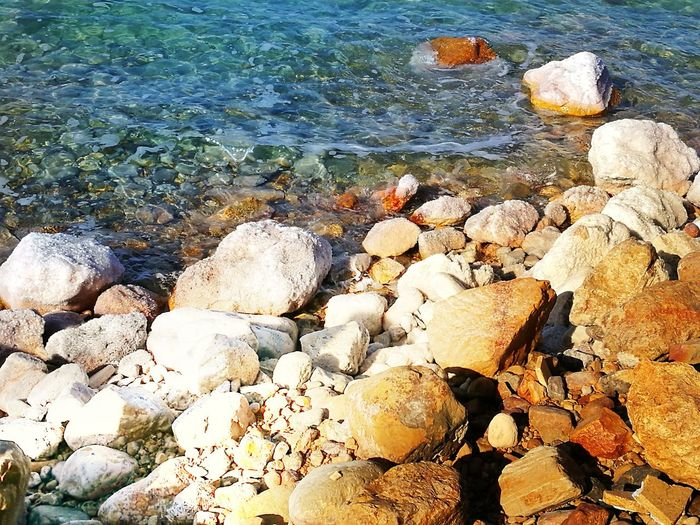 Dead sea Beach Water Nature Shore Pebble Day Outdoors Sea Pebble Beach Tranquility Beauty In Nature No People Tranquil Scene Sunlight Sand Scenics EyeEm Nature Lover EyeEmNewHere Blue Sea Saltwater Lost In The Landscape Connected By Travel