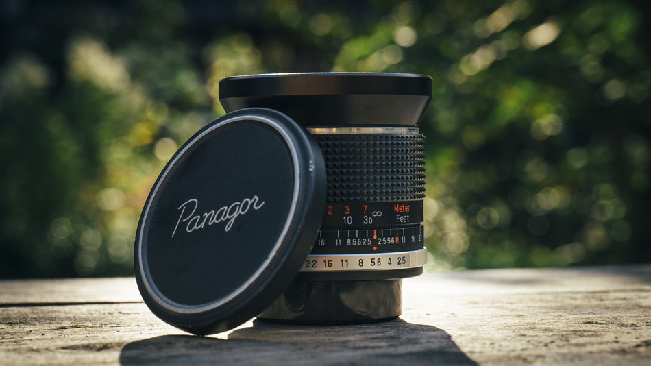 28mm 28mm F/2.5 Action Backlight Bokeh Cinema Close-up Film Focus On Foreground Green Color Man Made Object Manual Metal Old Panagor Retro Retro Lens Single Object Still Life Summer Tranquil Scene Tranquility Vintage Vintage Lens Wide Angle Lens