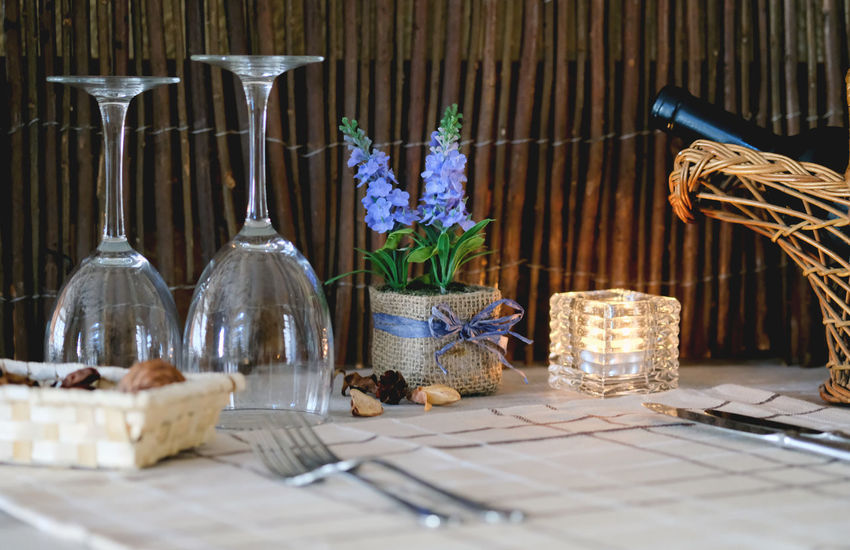 Table setting in a restaurant Celebration Food And Drink Glasses Knife Meal Time Reception Table Setting Table Arrangements Celebration Event Cozy Cozy Place Cutlery Indoors  Knife And Fork Lavender Napkin No People Nobody Place Setting Plate Restaurant Table Table Decoration Tablecloth Wineglasses